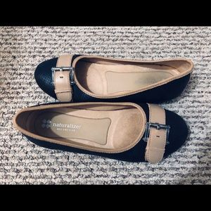 Tan and black buckle flats